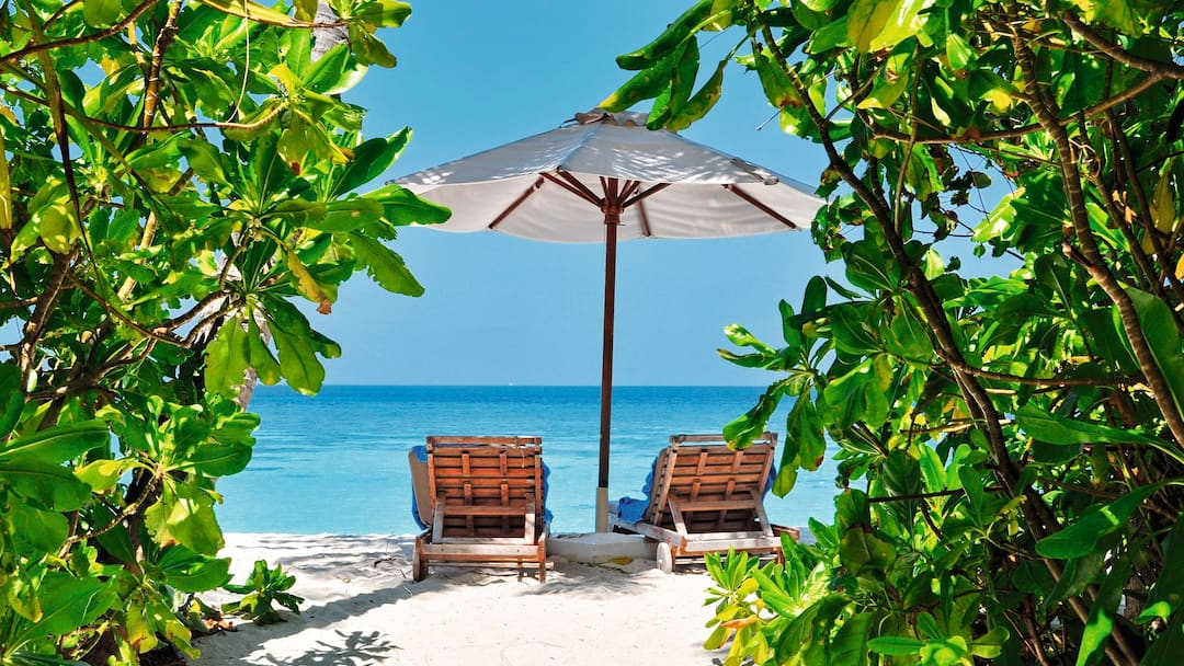 Private beach with umbrella and chairs