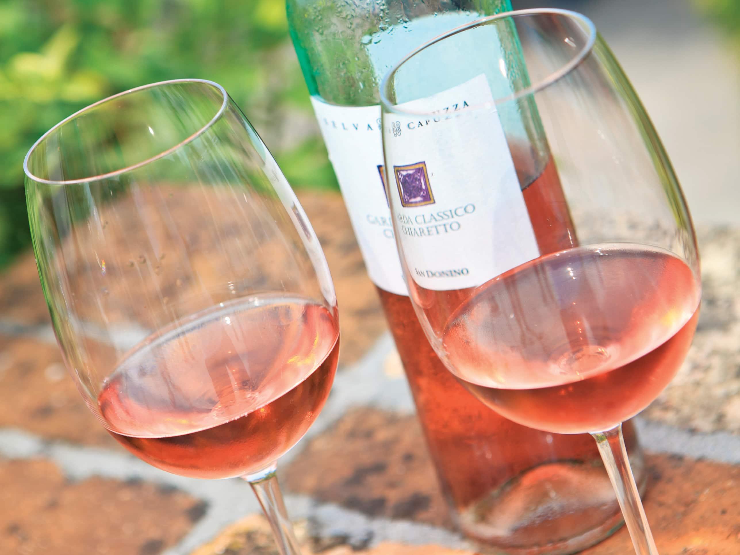 Chiaretto wine bottle and wine glasses