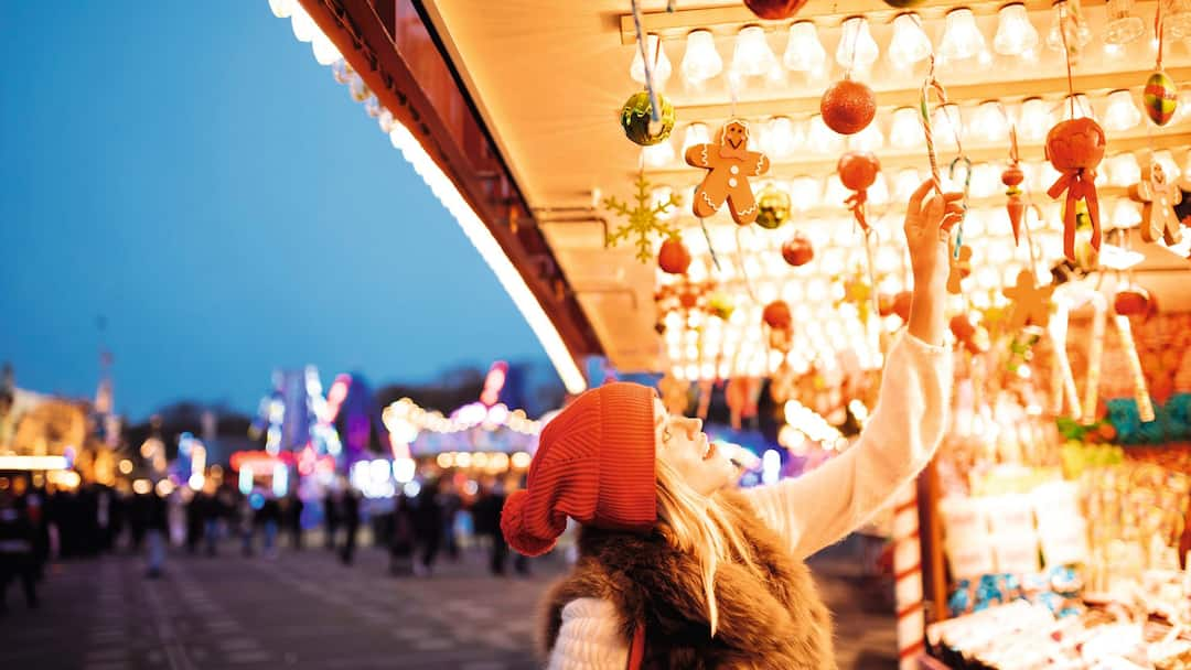 lady at a christmas market stall