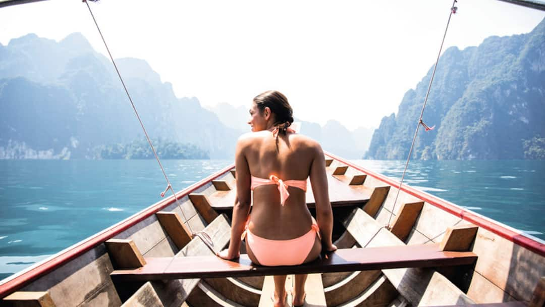 Lady in a bikini on a boat