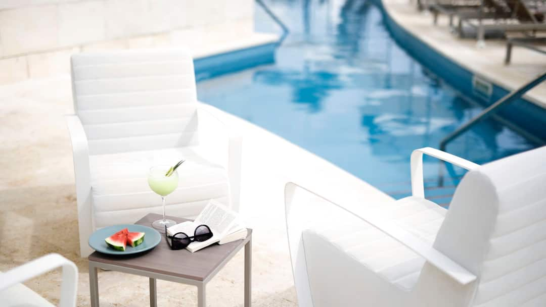 Table and chairs by pool