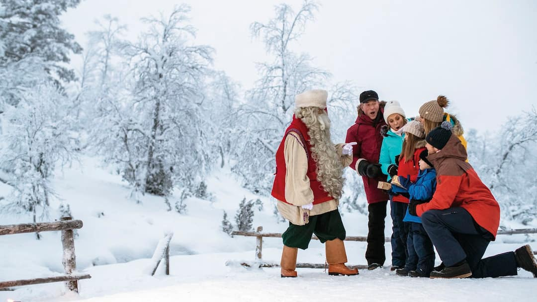 Family meeting Santa in the snow