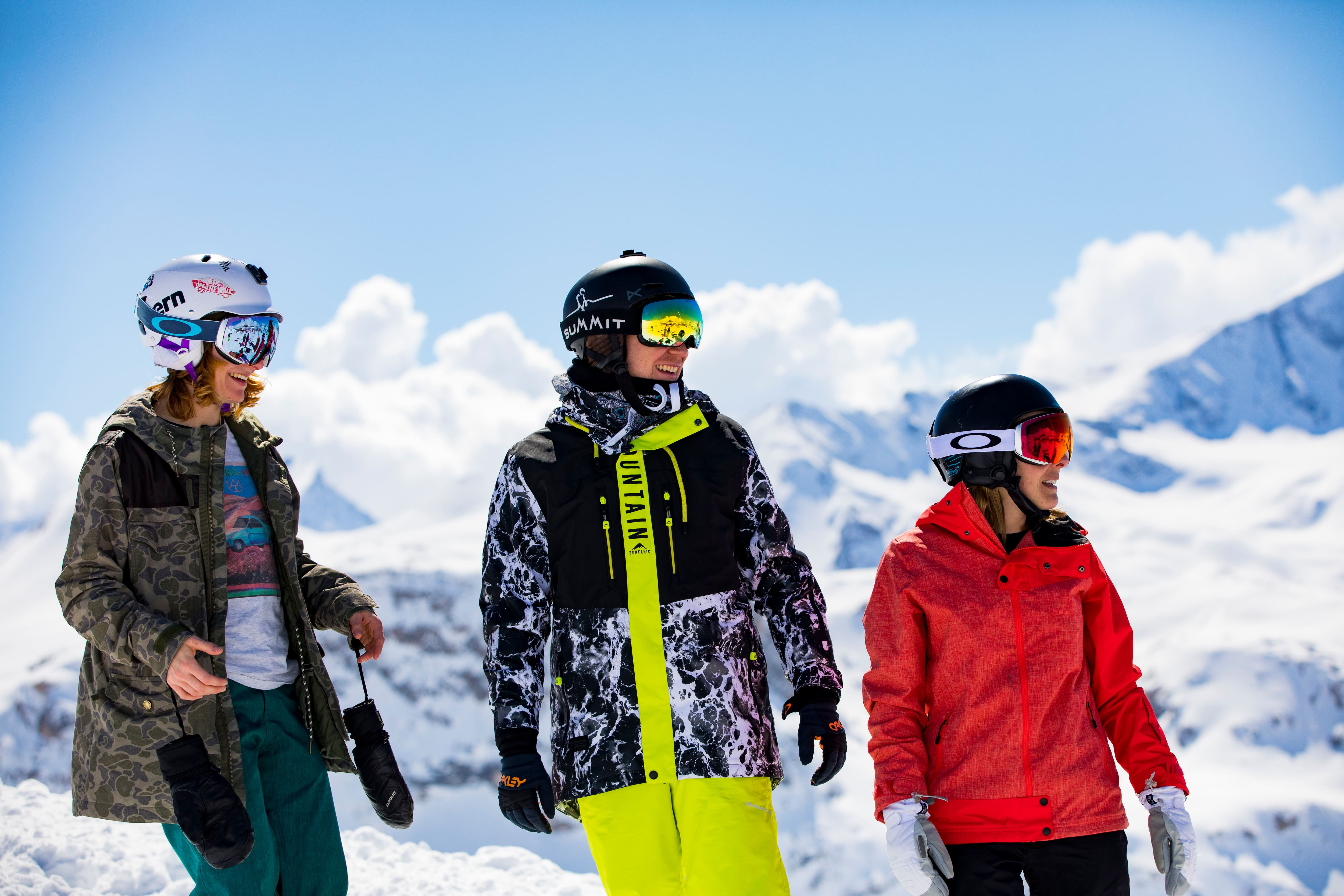 Skiers standing on the mountain