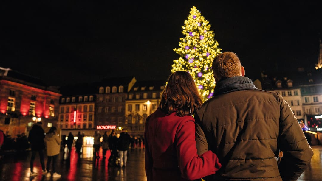 couple looking at christmas tree