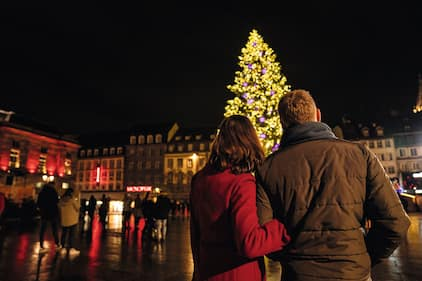 couple watching christmas tree