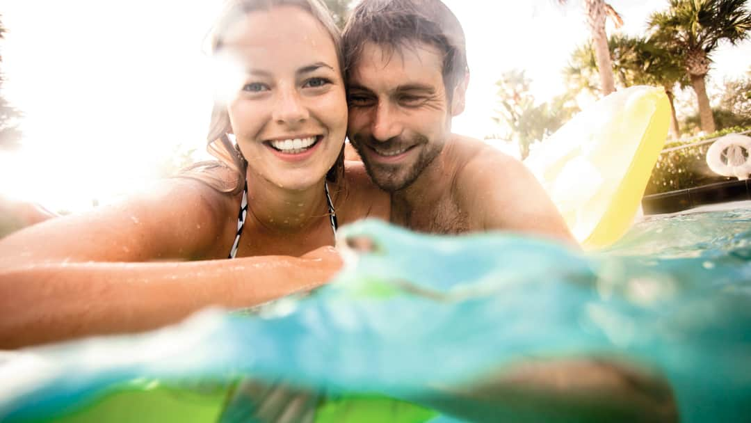 Family couple in pool